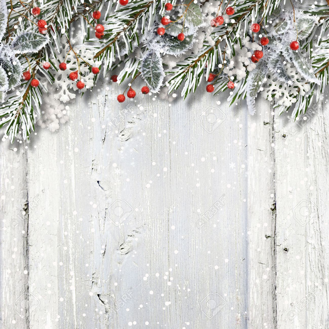 Christmas wooden background with fir branches and holly - 48862612