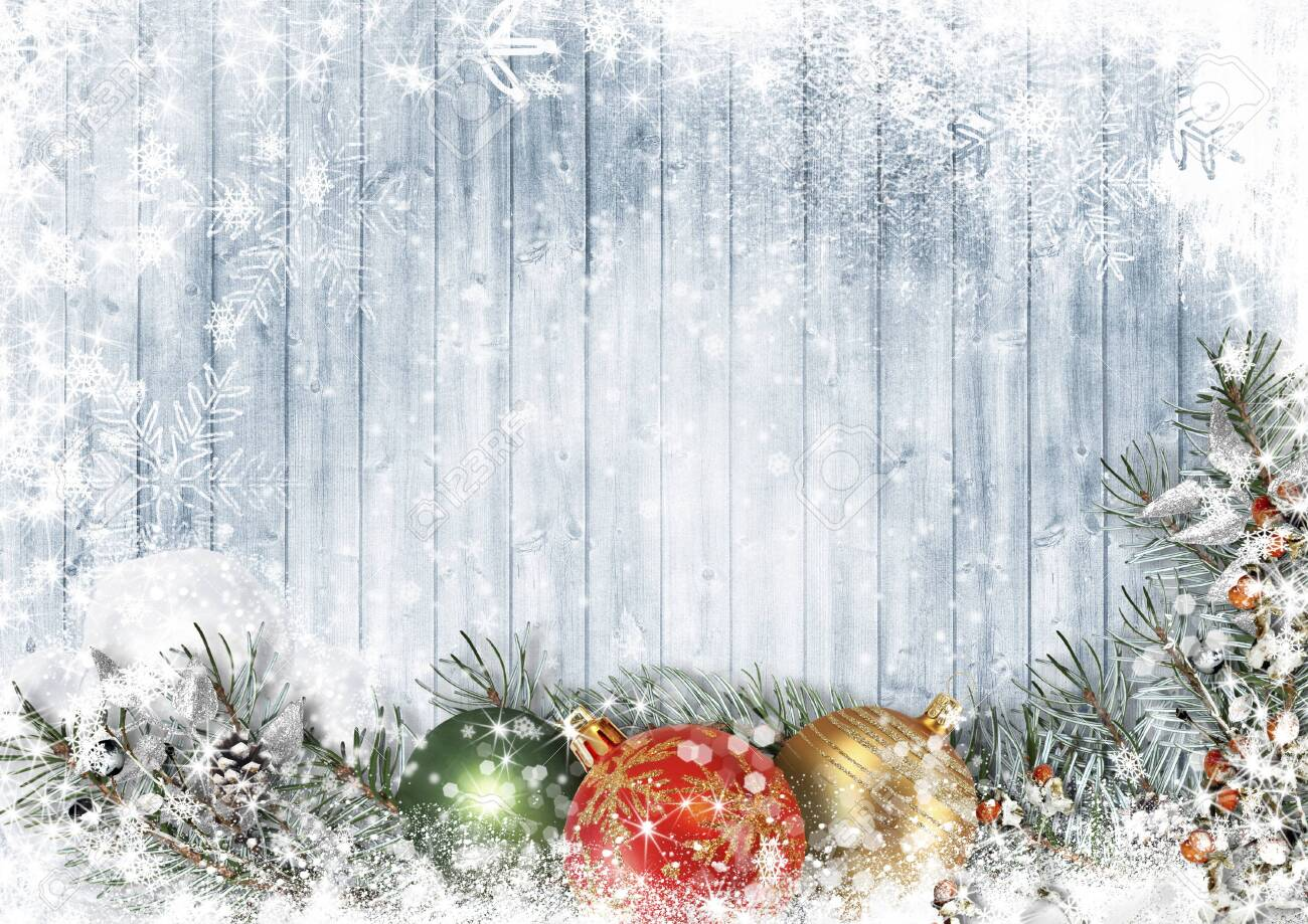 Christmas wood texture with garland with balls, snow and firtree - 134938983