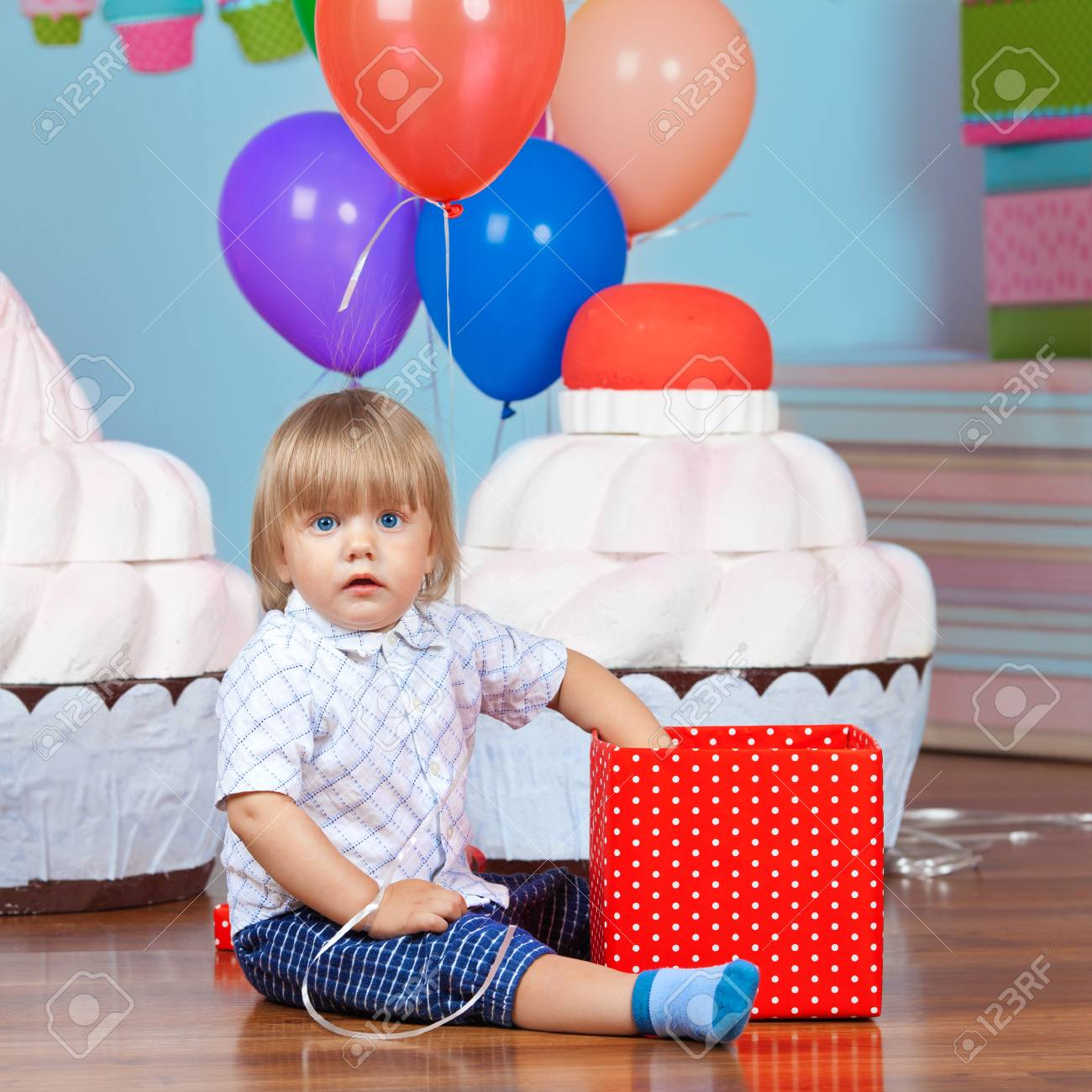 Little Boy Opening His First Birthday Present Stock Photo