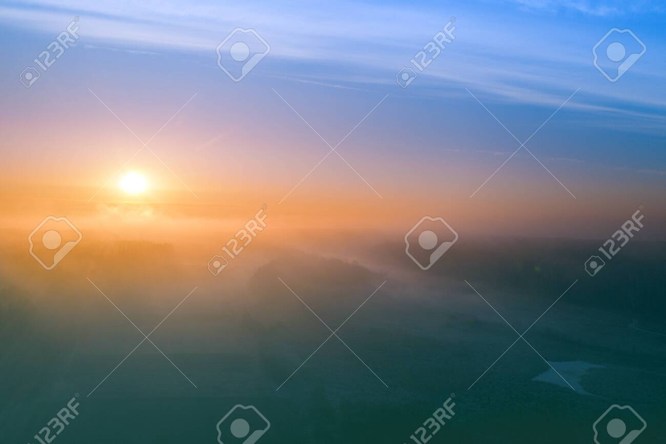 Early misty morning. Sunrise in countryside. Rural landscape in early spring. Aerial view - 149776953