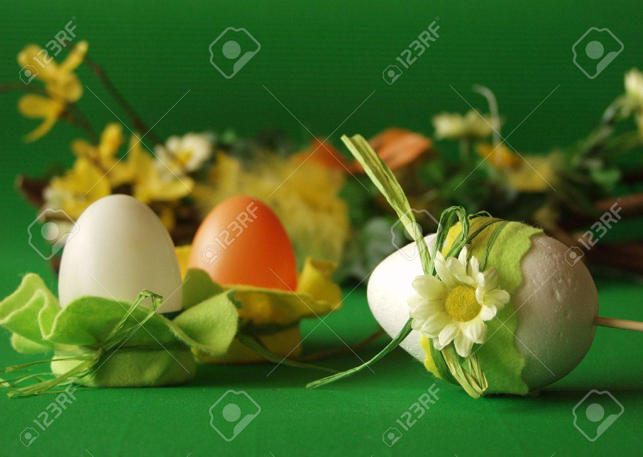 Easter eggs, flower decoration, green background Stock Photo - 370217