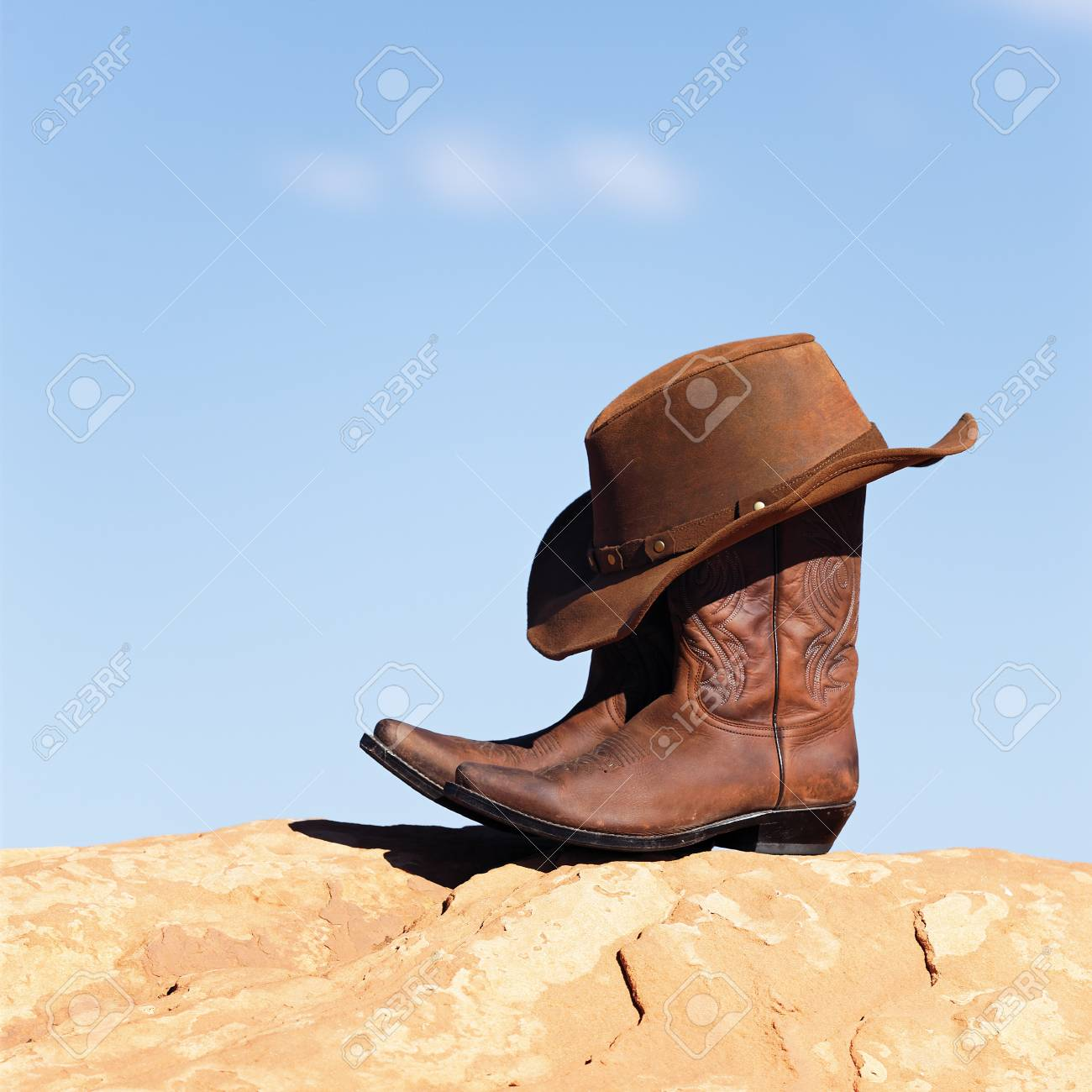 brown cowboy hat and boots outdoor Stock Photo - 16100060 172ea3d95f9