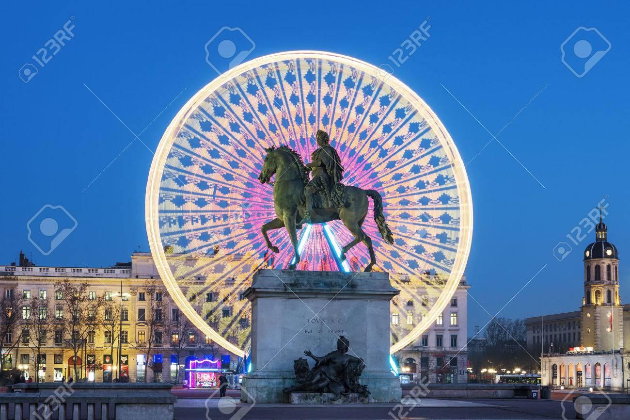 Place Bellecour statue of King Louis XIV by night, Lyon France - 35398807