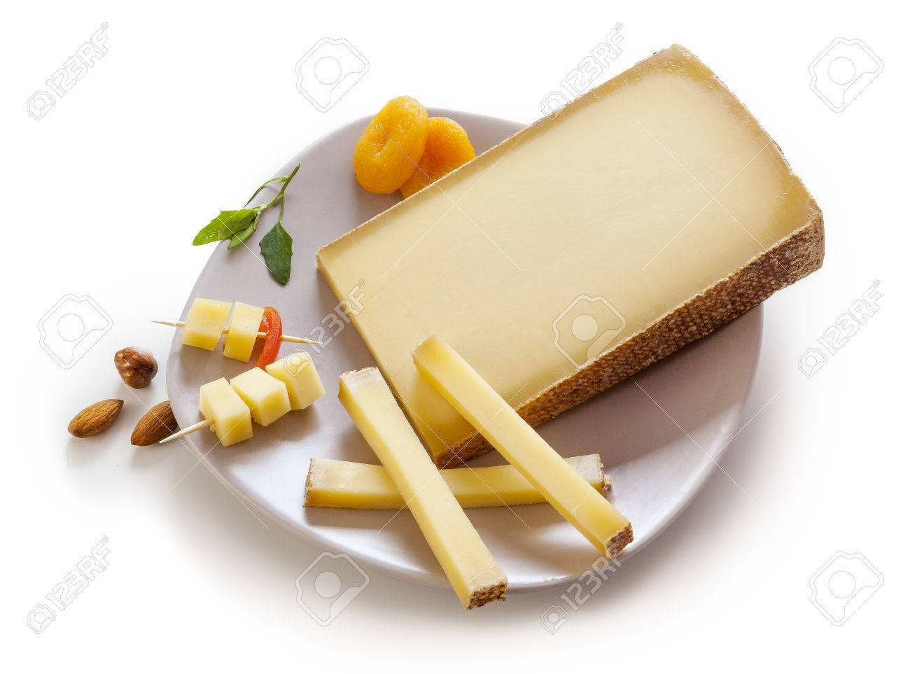 Swiss Gruyere cheese in a plate on white background - 41988358