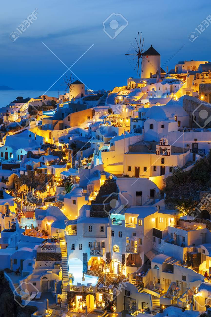 Lights of Oia village at night, Santorini, Greece. - 60687990