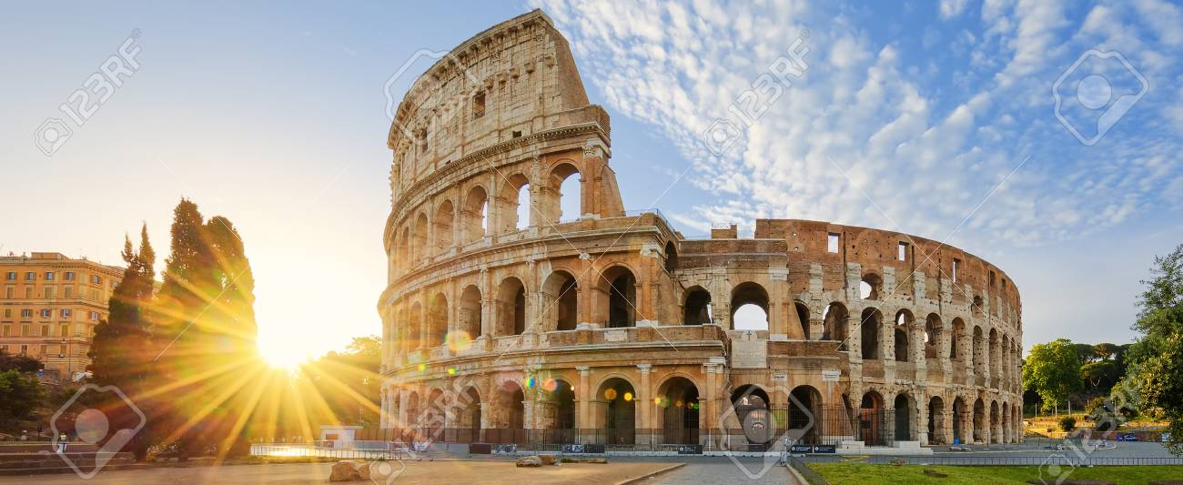 Panoramic view of Colosseum in Rome and morning sun, Italy, Europe. - 65060771