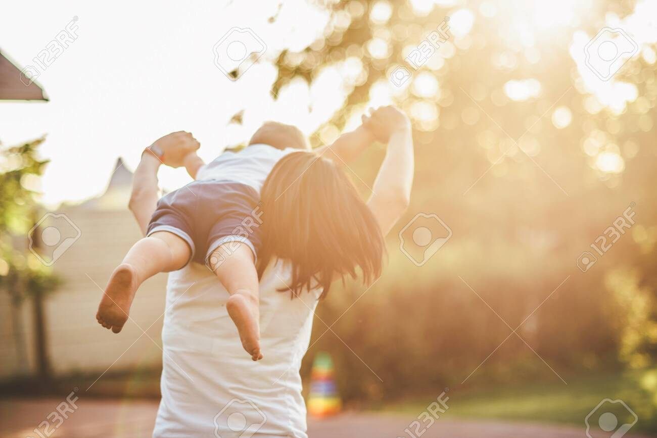 mom and child playing in the yard - 148364477