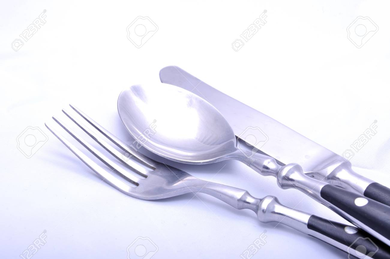 Steel cutlery - knife, fork and spoon, isolated on white. Stock Photo - 7461955
