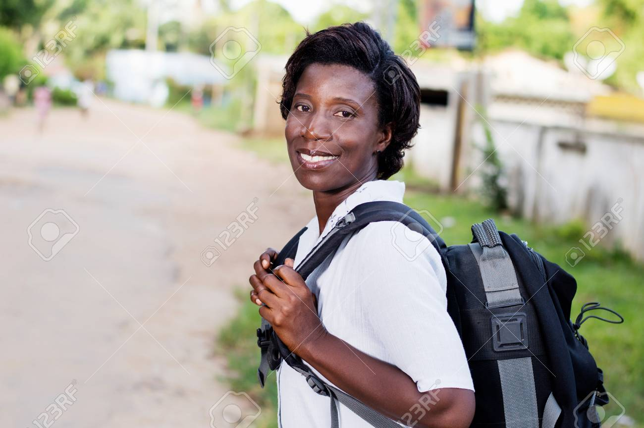 Travel, tourism - smiling young woman with backpack ready to hit the road. Banque d'images - 95666533