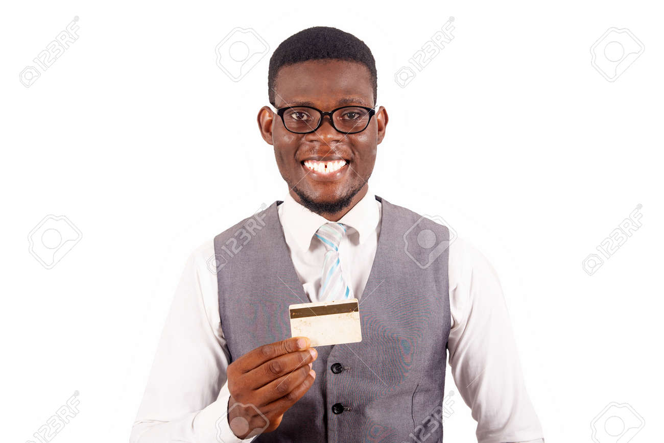 Handsome business man holding credit card with a happy face standing and smiling with a confident smile showing teeth - 167144392