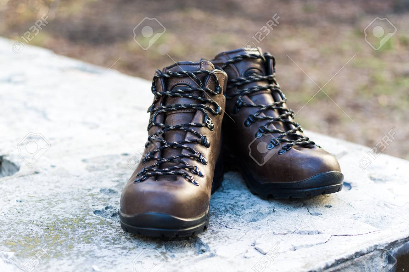 Men's shoes. Men's hiking boots. Brown leather boots. Front view.