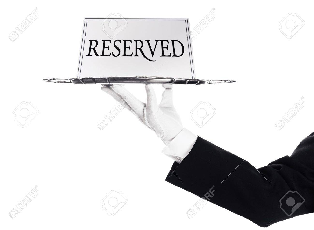 Reserved -A hand holding a silver tray with reserved sign Stock Photo - 17649191