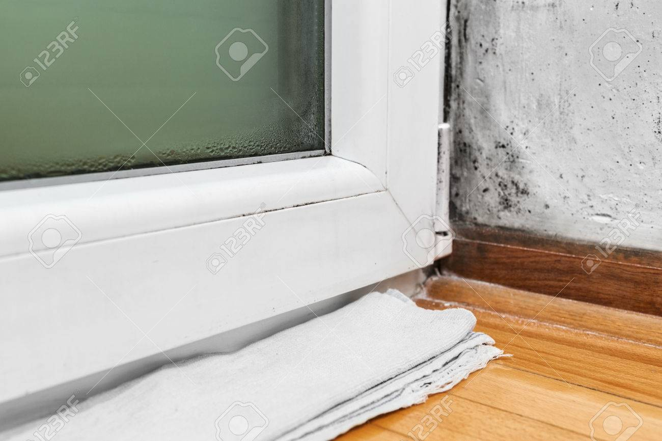 Condensation Cause Mold And Moisture In The House  Towel Absorbs Water From  The Window Stock
