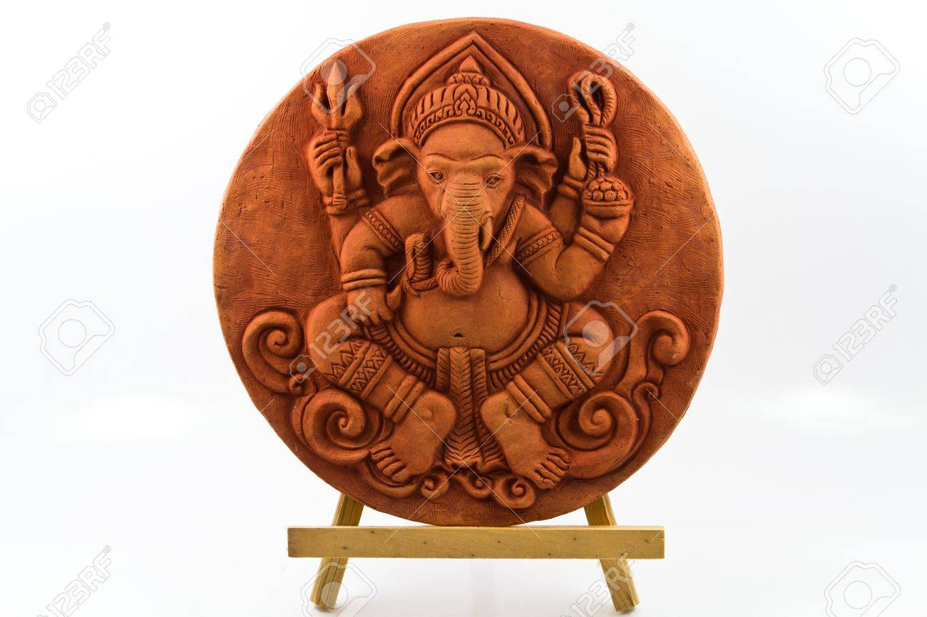 sphere of clay ganesh statue on wooden base. stock photo, picture
