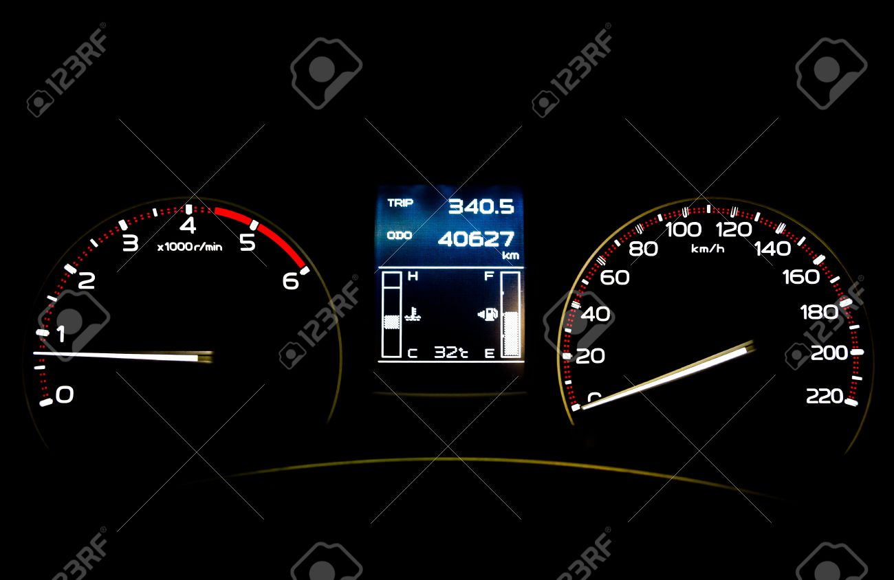 speedometer in car with lcd display of odometer and trip calculator
