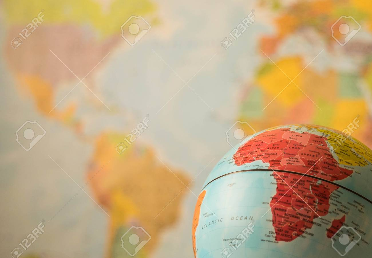 africa map on a globe with the whole world as background stock photo