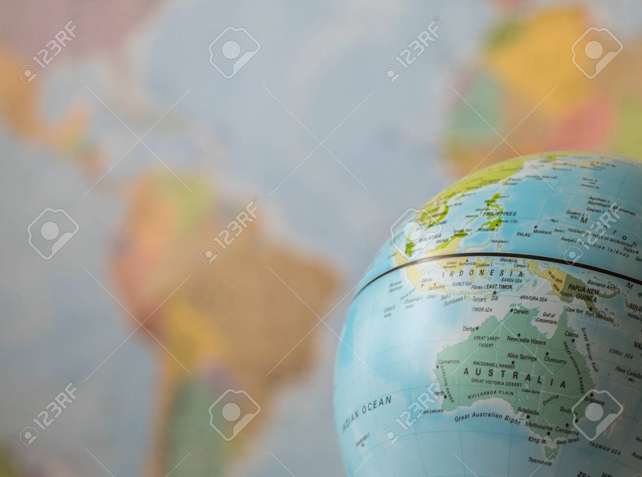 Australia Map On A Globe With The Whole World As Background Stock ...