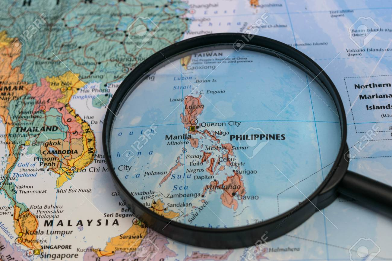 Map of the philippines through magnifying glass on a world map map of the philippines through magnifying glass on a world map stock photo 93041243 publicscrutiny Images
