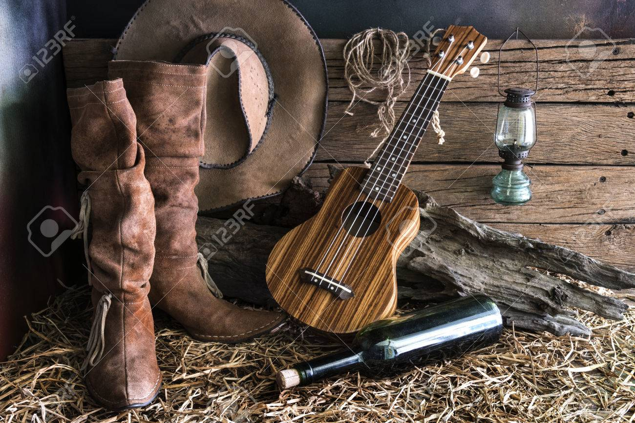 6b394a5640d Still life photography with ukulele on american west rodeo brown felt  cowboy hat and traditional leather