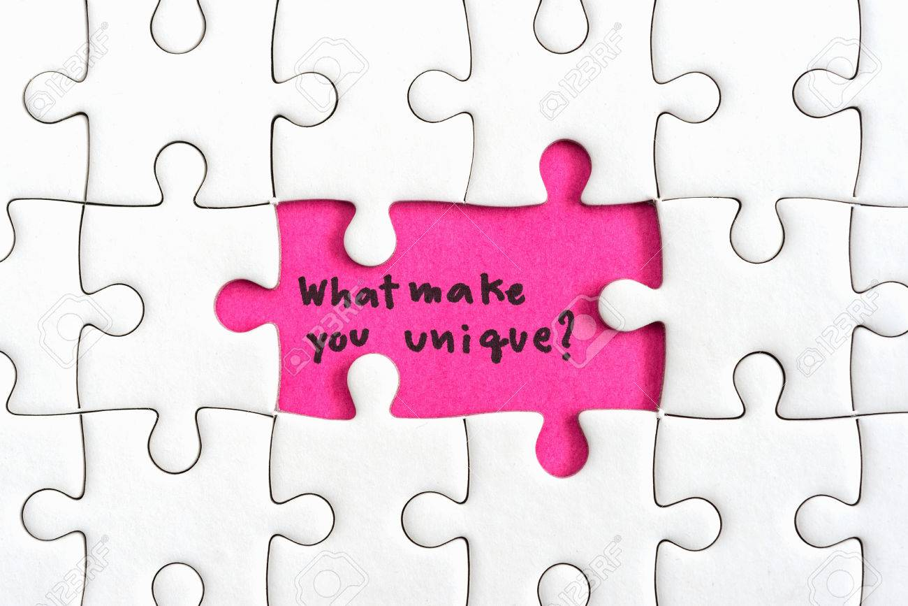 Jigsaw Puzzle Piece With Two Missing And Hand Writing Letters