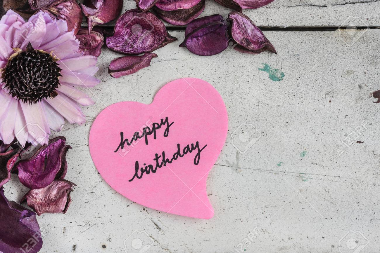 Happy Birthday Note In Heart Shape Paper With Pink Flowers And