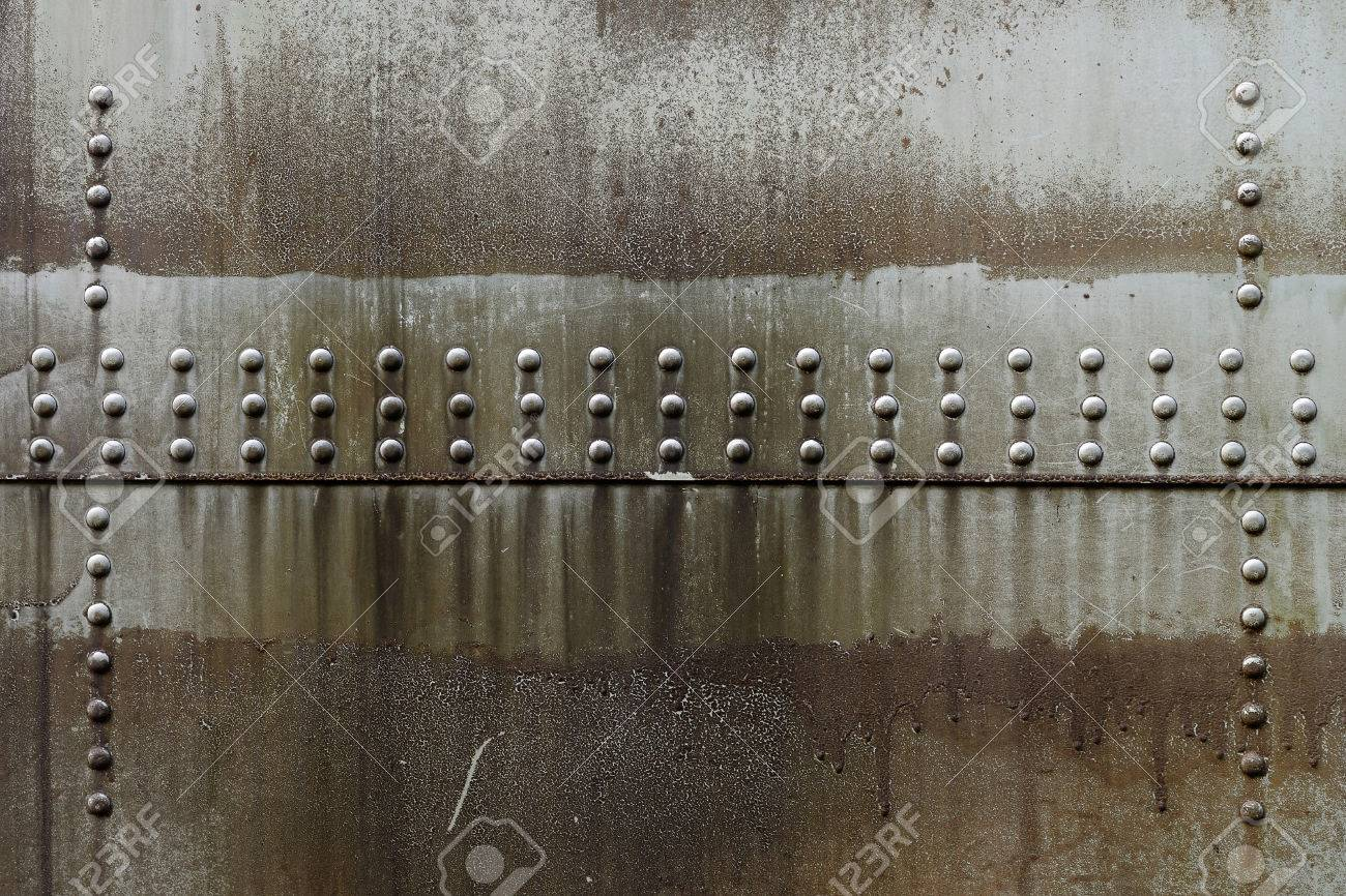 Dirty oil stains on metal surface of riveted metal from aircraft - 30451193