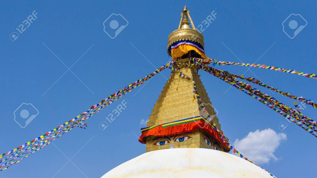 The close-up shot to the eye of the Boudhanath Stupa Located in Kathmandu, Nepal. - 128411611