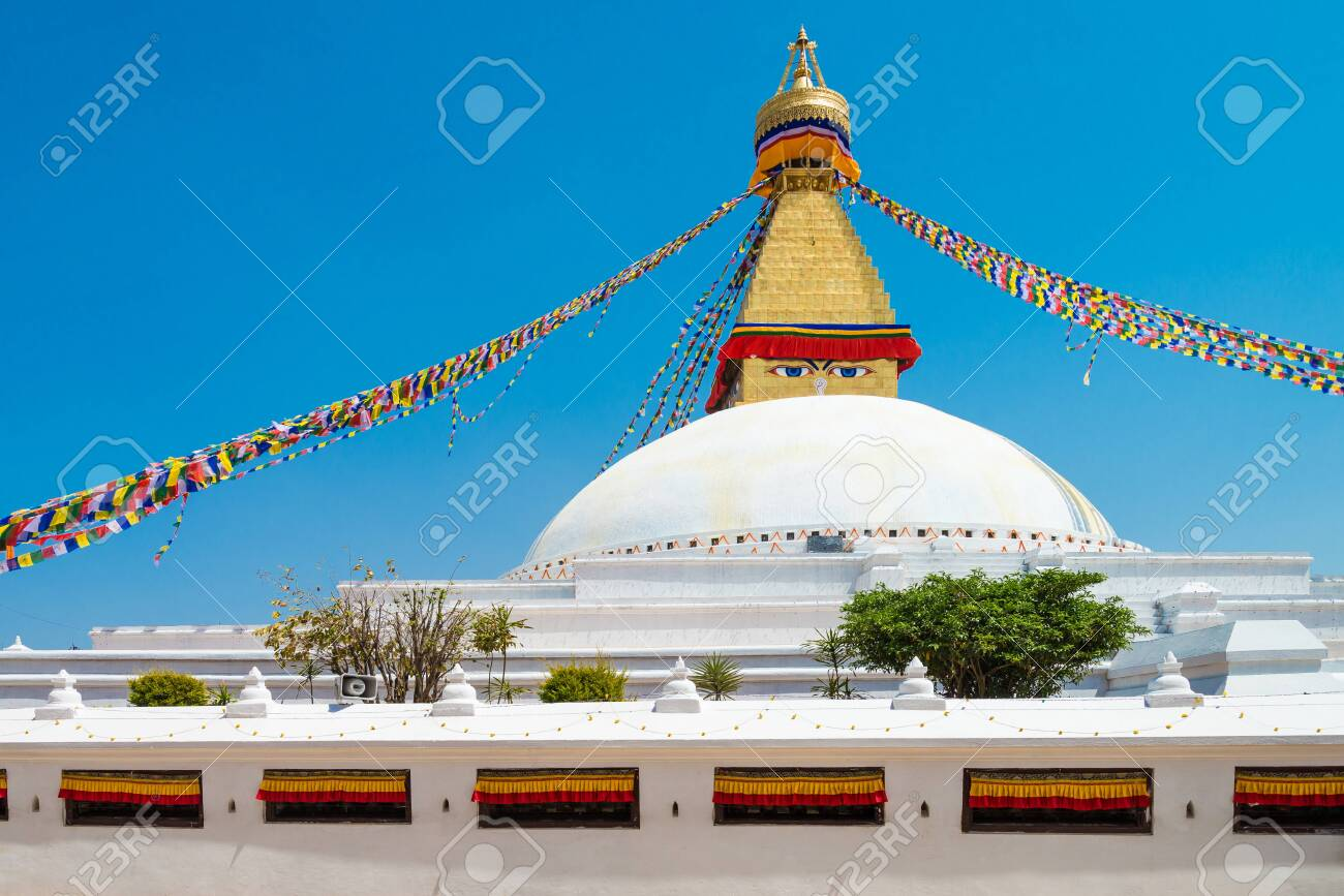 The Buddhist stupa of Boudha Stupa dominates the skyline. It is one of the largest unique structures stupas in the world Located in kathmandu, Nepal. - 128411930
