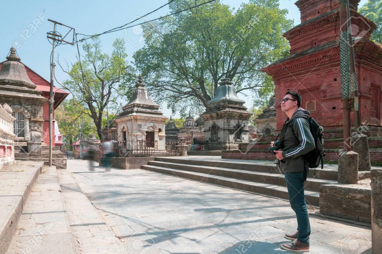 An asian man tourist enjoy viewing historic building at Gorakhnath Temple, Nepal - 128412559