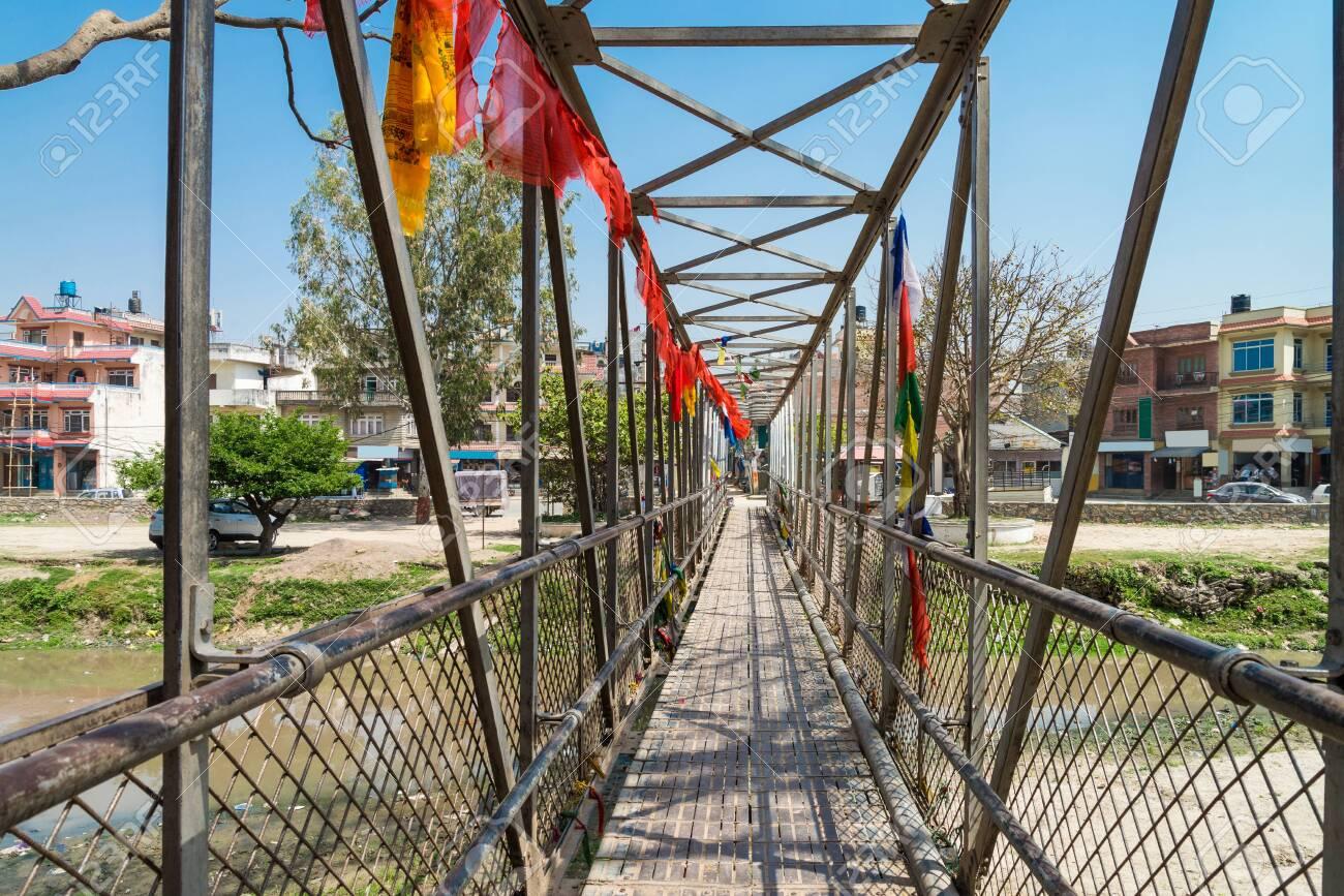 The local small metal bridge for cross bagmati river near Guhyeshwari Temple, Nepal - 128412568