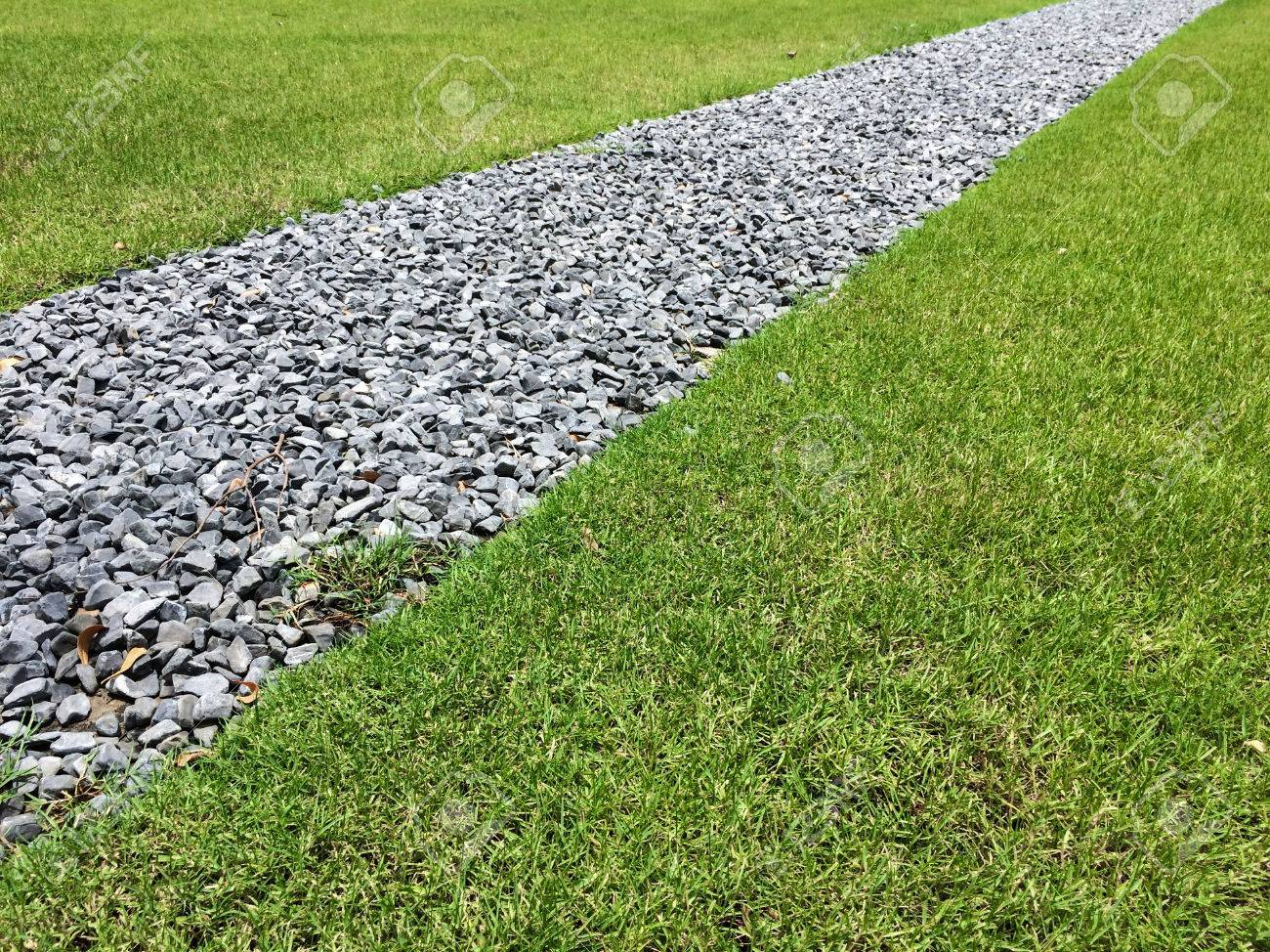 Gray Gravel Walking Path In A Grass Field/lawn Of A Garden Stock Photo