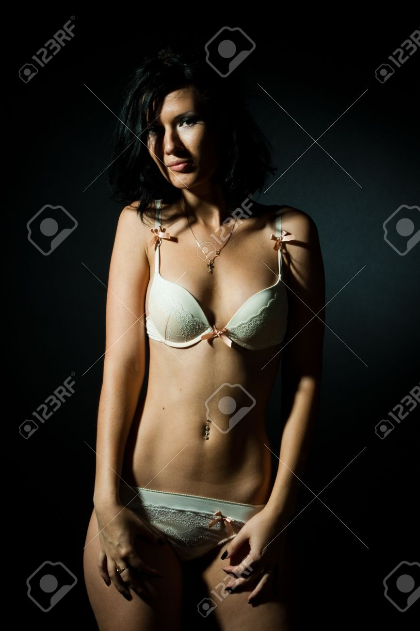 brunet sexi girl on theblack background looking at camera stock