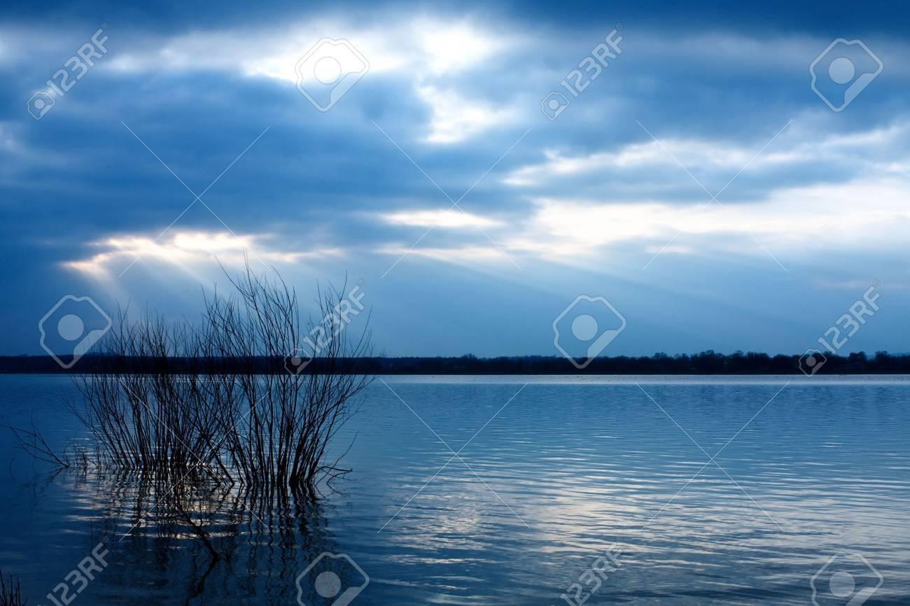 Sunset over blue lake Stock Photo - 6190393
