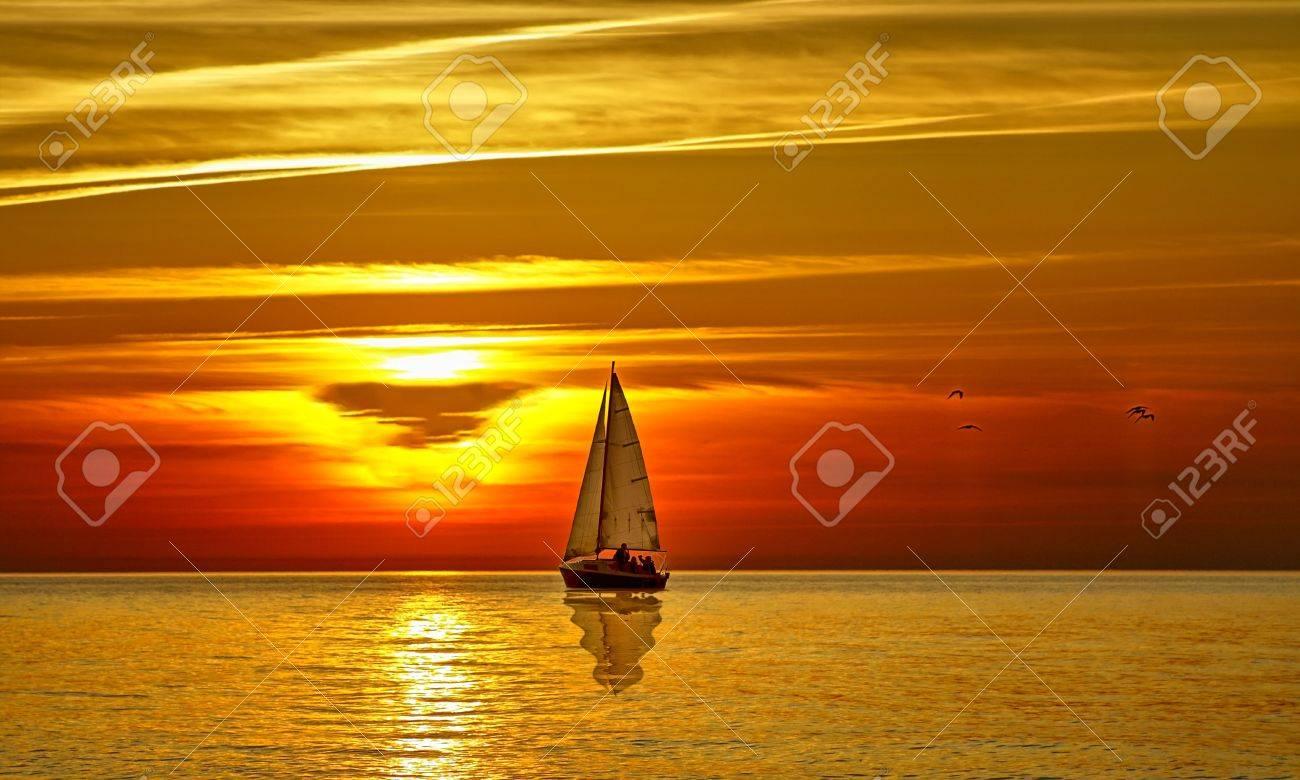 Sailboat at sunset - 8804536