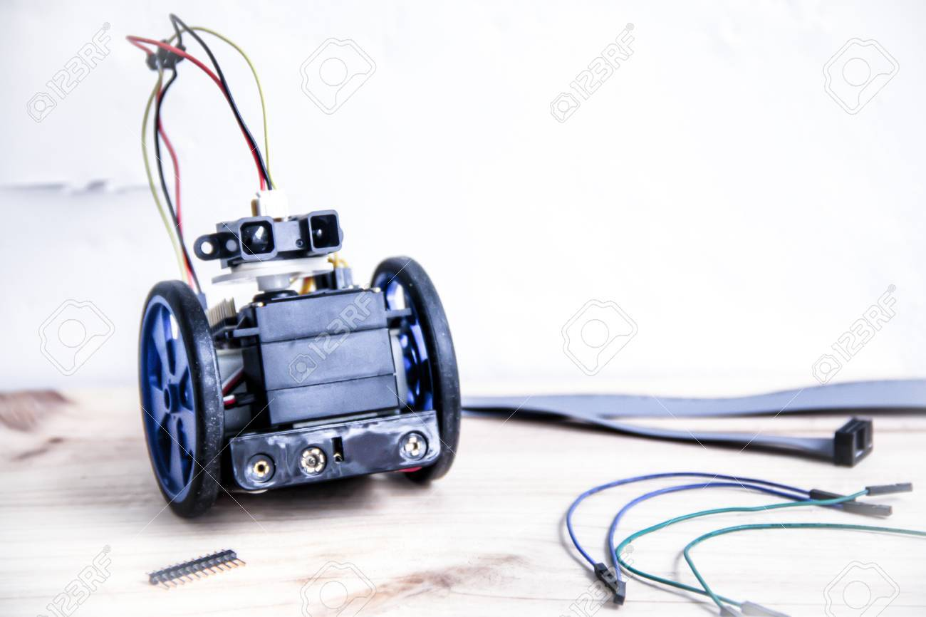 Building A Robot With Motors Wheels And A Sensor With Wires And ...