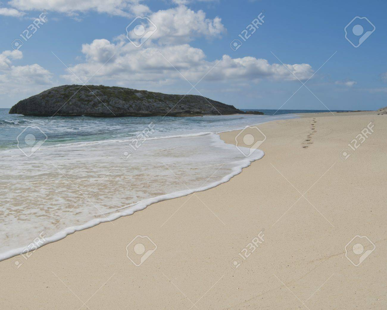 footprints on a beach being erased by the surf on a Bahamas beach Stock Photo - 12819895