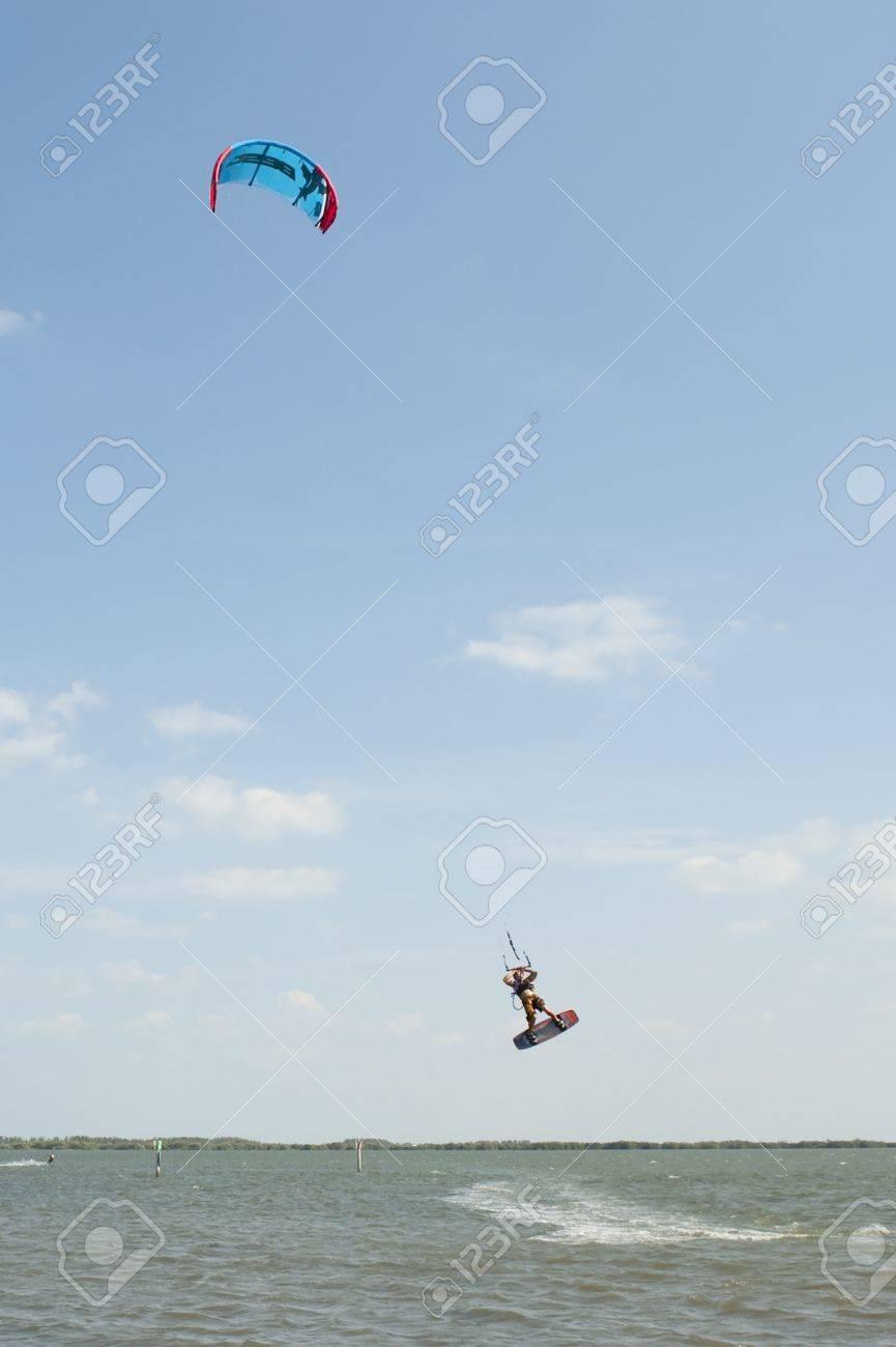 Kite Surfer catching air in Banana River near Cocoa Beach Florida Stock Photo - 13205348