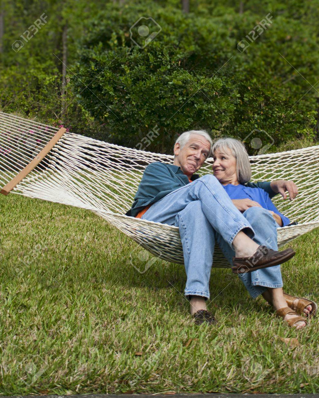 expressive senior couple in hammock age 550-60 Stock Photo - 15059662