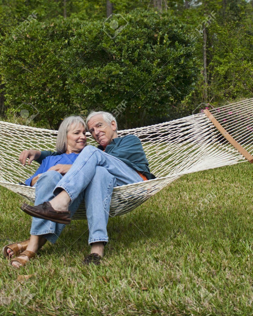 expressive senior couple in hammock age 550-60 Stock Photo - 15059703