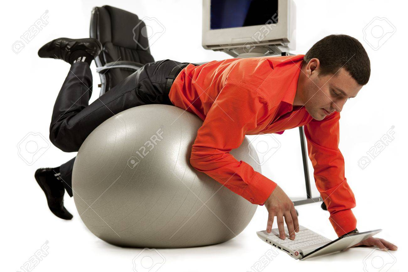 Young businessman doing push-ups and looking on laptop screen Stock Photo - 14078975