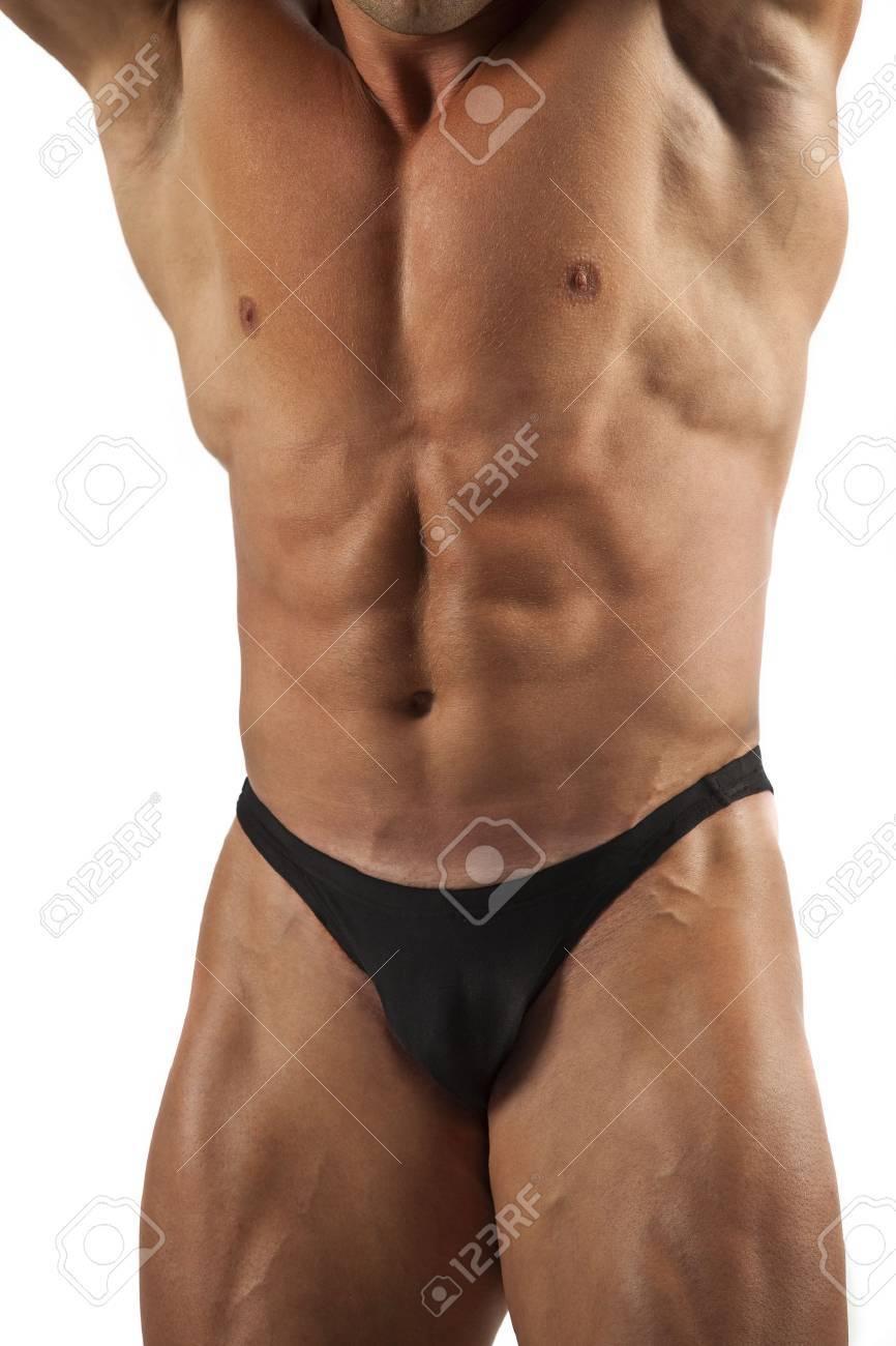 Muscled model posing.Isolated on white background Stock Photo - 14068282