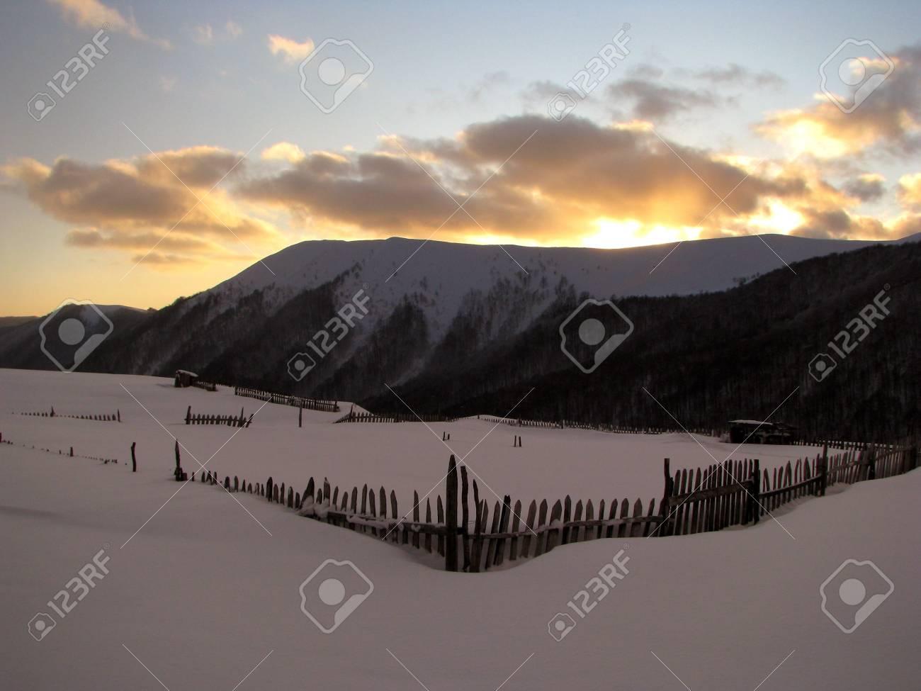 Winter sundown. Winter sunset in the mountainous village. Scenic twilight Stock Photo - 6074070
