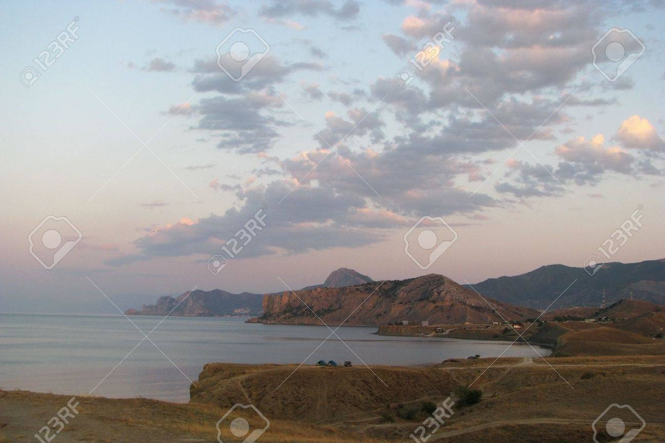 Early morning. Cloud-drift over South Coast of Crimea. Morning twilight in the coast of Black Sea. Stock Photo - 6348083