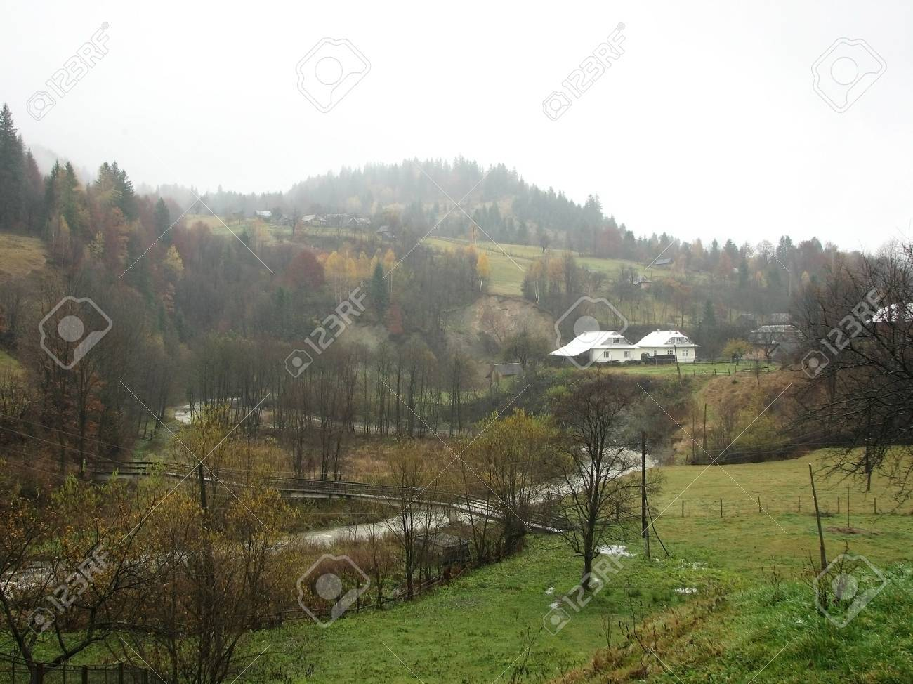 Rural landscape. Village in the East Carpathian Mts. Foggy day in the mountainous village. Stock Photo - 6392297