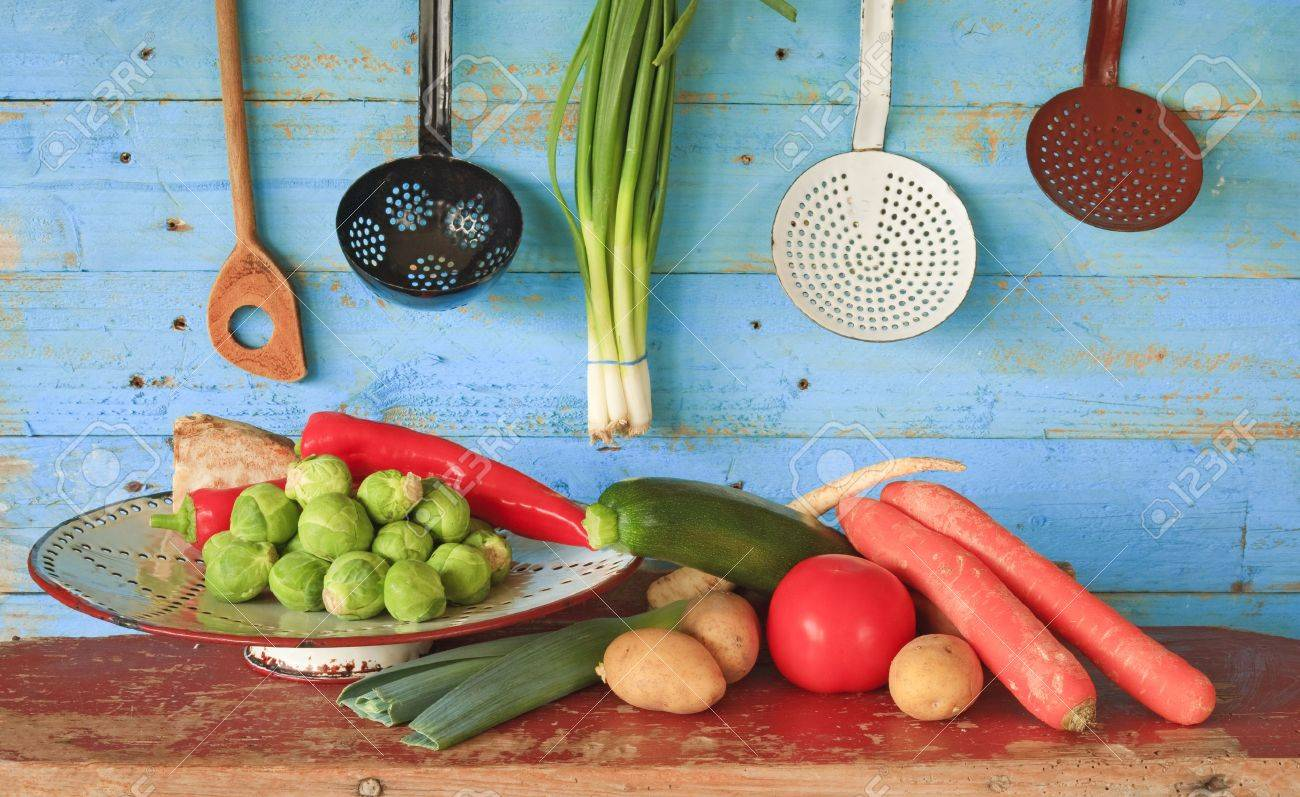 various vegetables and vintage kitchen equipment - 25249422