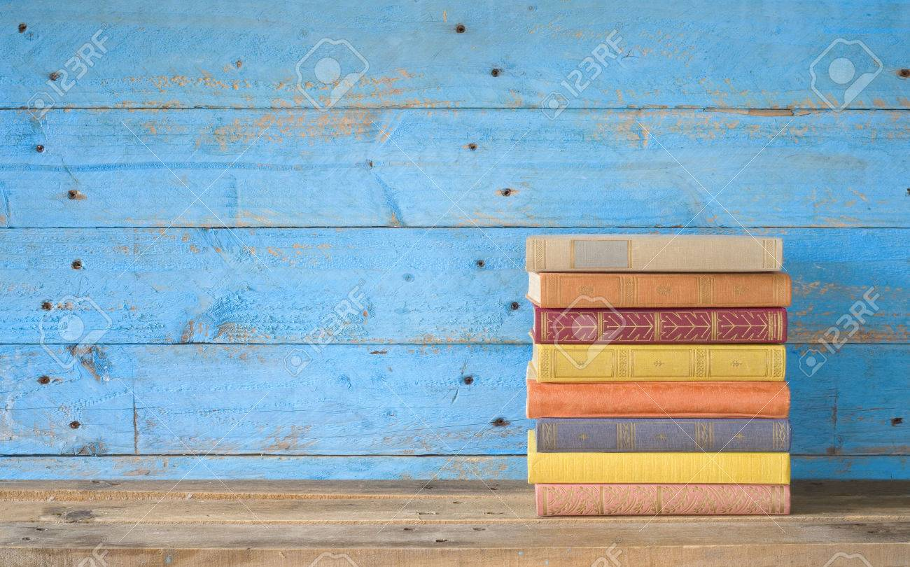 colorful books on a wooden shelf, free copy space - 30113780