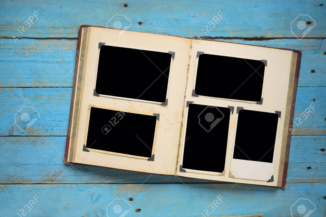 vintage book with empty photo frames, photo corners - 31127271