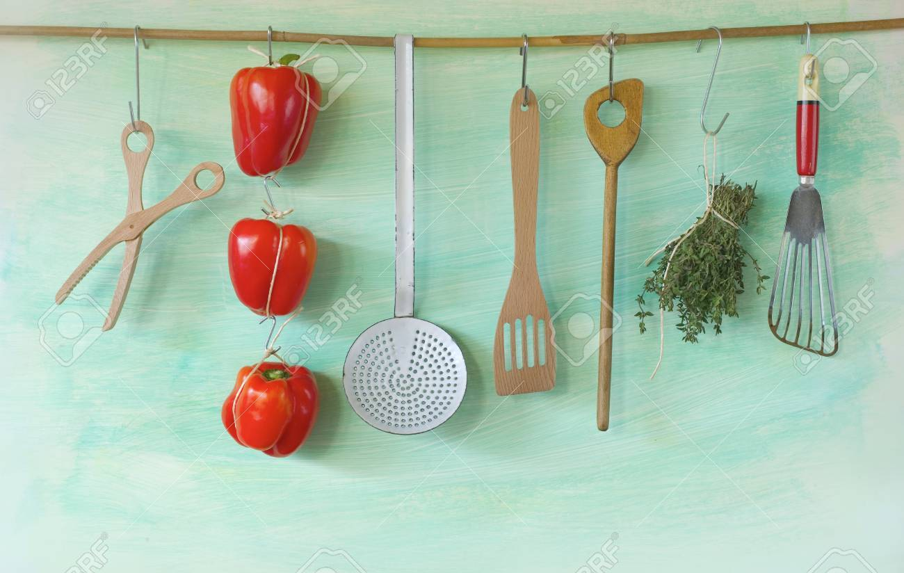 Hanging Vintage Kitchen Utensils W. Herbs And Bell Pepper, Cooking ...