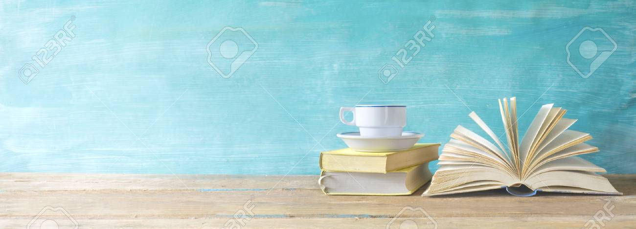 opened book, cup of coffee on grungy background, panoramic, copy space - 77439342