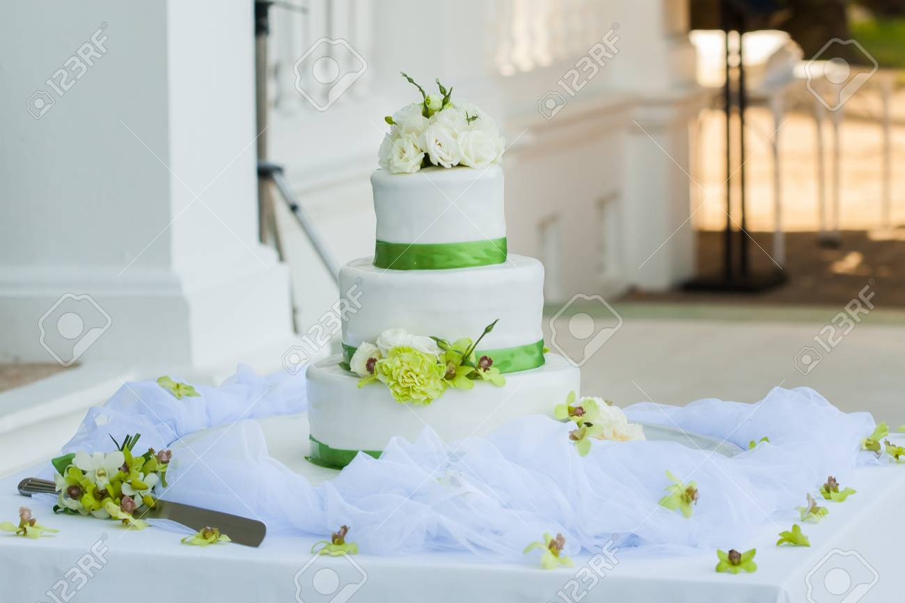 White Wedding Cake With Real Roses Decorations Stock Photo Picture